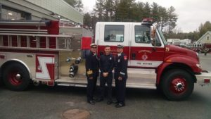 Left-to-right: Maynard Fire Chief Anthony Stowers, Firefighter Michael Cisek and Captain Sean Kiley at Cisek's graduation at the Massachusetts Firefighting Academy. (Courtesy Photo)