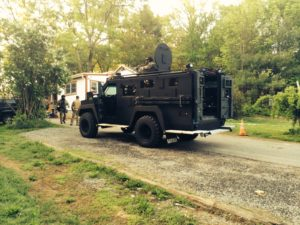 The CEMLEC Swat Team at the suspect's home (Photo courtesy of the Boxborough Police Department)