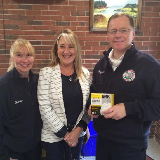 The Georgetown Fire Department donated $500 worth of smoke detectors to the Georgetown Housing Authority. Left to right: Firefighter Donna Robbins, Housing Authority Director Diane Drinan and Chief Fred Mitchell. (Courtesy Photo)